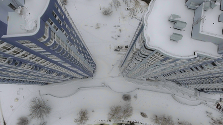 Panorama home downward movement of the air. It is snow on the roof. Taking the building from the air overhead view.
