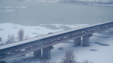 top view on the bridge with cars and train. Urban city view in winter Stock Photo - 117835868