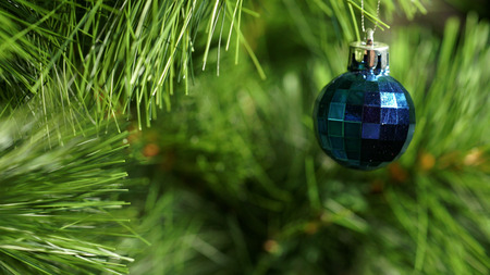 Panorama blue fur-tree toy on a green Christmas tree