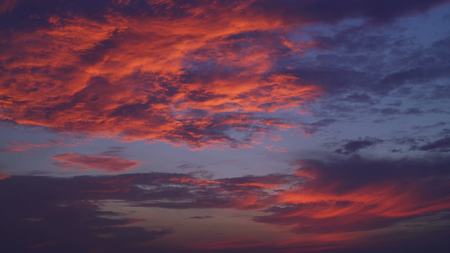 evening sky with thunderclouds. Natural view with blue and red, magenta colors clouds. Stock Photo - 117835957