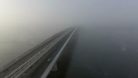 The Invading Fog over Kiev, Bridge subway, riding cars, heavy fog.