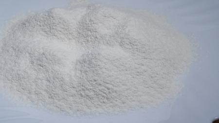 Sifting flour on white plate. Stock Photo - 117836368
