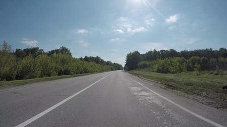 Driving on the highway near the forest. Video 4k, UHD.