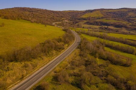 Aerial Drone Foto View Carpathian mountains in the fall, road through the ridge