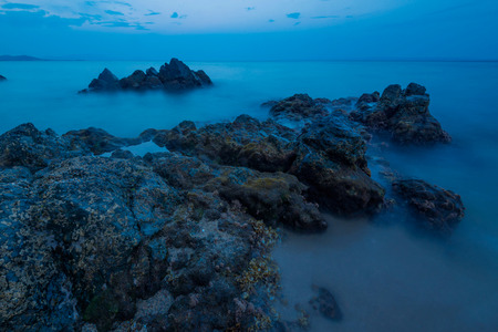 long exposure near the blue sea of chalkidiki. Blue hour and some rocks covered in water