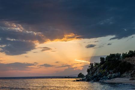 amazing sunlight rays over the sea of chalkidiki Stock Photo