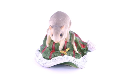 Christmas mouse on a Christmas hat Stock Photo