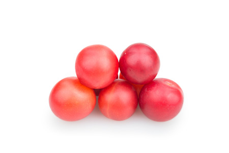 alycha: red plums on a white background