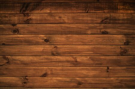 a background with a beautiful structure of horizontal wooden boards of brown color