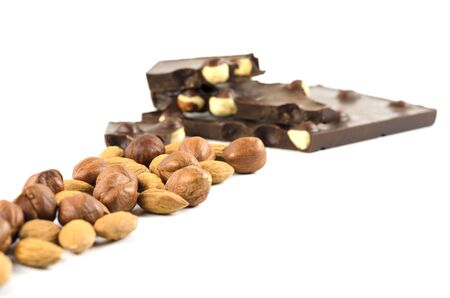 Mendal and hazelnuts with chocolate on a white background Stock fotó