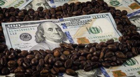 Roasted coffee beans with American dollars