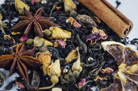 Black tea with anise, dry lemon and cinnamon sticks Reklamní fotografie