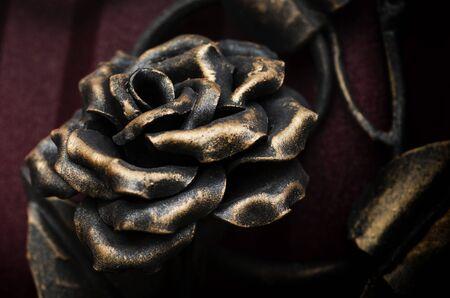 Beautiful decorative rose on a metal gate