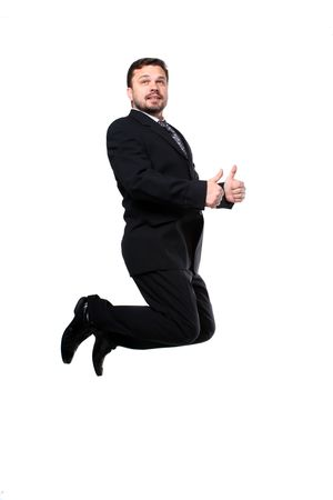 Business man jumping with thumbs up isolated over a white background  Stock Photo - 7078556