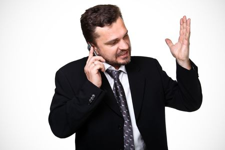 Portrait of a mature business man screaming in his cellphone over white Stock Photo - 7078750