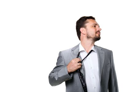 Tired businessman taking off his tie. Isolated on white. Stock Photo - 7078771