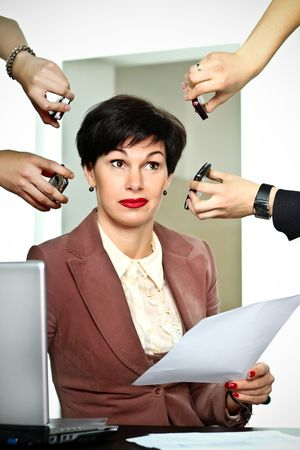 Business woman with lots of incoming calls photo