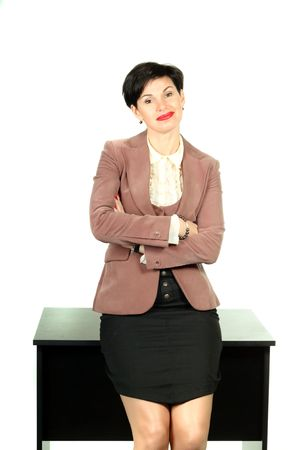Beautiful business woman worried sittting on the table photo