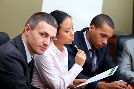 Multi ethnic business team at a meeting. Focus on woman Stock Photo - 9282551