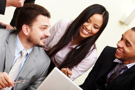 Multi ethnic business team at a meeting. Interacting. Stock Photo - 9282969