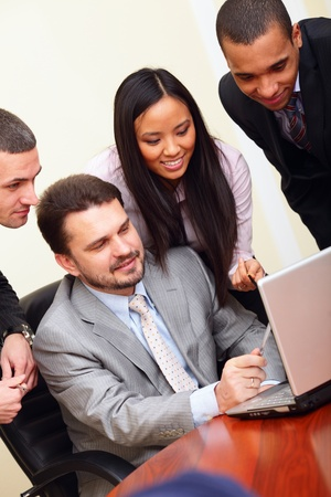 interacting: Multi ethnic business team at a meeting. Interacting. Stock Photo