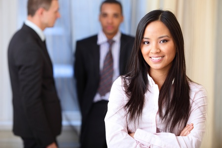 Portrait of a young beautiful asian woman in a business environment photo