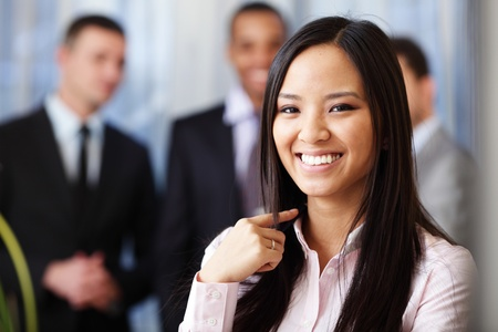 Portrait of a young beautiful asian woman in a business environment Stock Photo - 9282819
