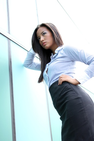 A pretty asian business woman at the office building  Stock Photo - 9282507