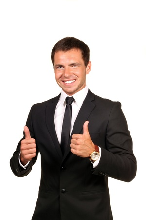 Young happy business man going thumbs up, isolated on white Stock Photo