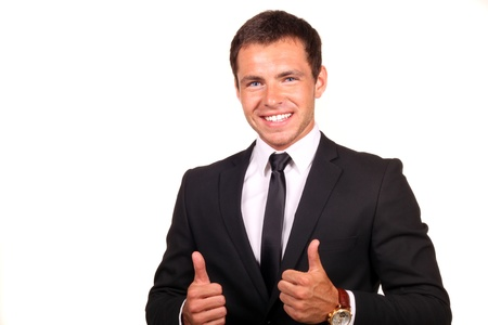 Young happy business man going thumbs up, isolated on white photo