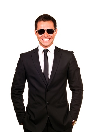 Young professional smiling with sunglasses on a white background