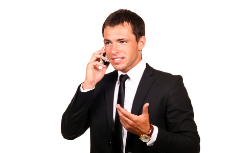 businessman phone: Portrait of a handsome young business man on cell phone Stock Photo