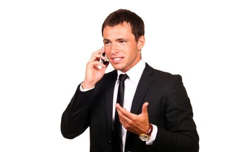hablando por telefono: Retrato de un hombre apuesto joven empresa de telefon�a celular Foto de archivo