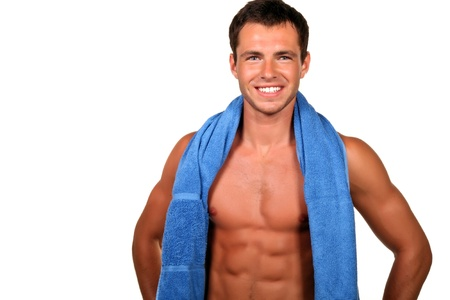 Handsome muscular man with the towel. photo