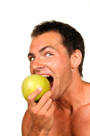 Young man Holding Green Apple  photo