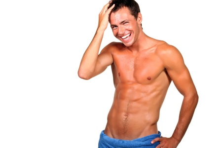Handsome muscular man with the towel. Stock Photo