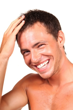 man mouth: Closeup of a happy young man looking at camera and touching his hair