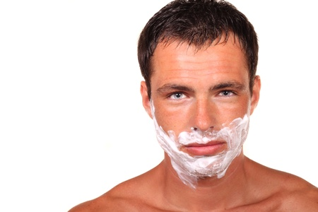 musculine: Angry handsome young man with a shaving foam