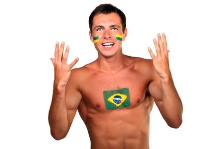 Portrait of a brazilian football fan with flag on his body and face, isolated on white photo