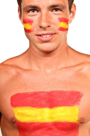 Portrait of a spanish football fan with flag on his body and face, isolated on white photo