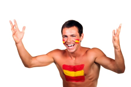 Cheerful happy spanish football fan with flag on his body and face, isolated on white photo