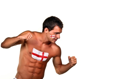 Portrait of an english football fan with flag on his body and face, isolated on white photo