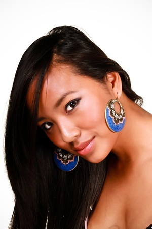 Closeup portrait of a young beautiful asian model with makeup and jewelry photo