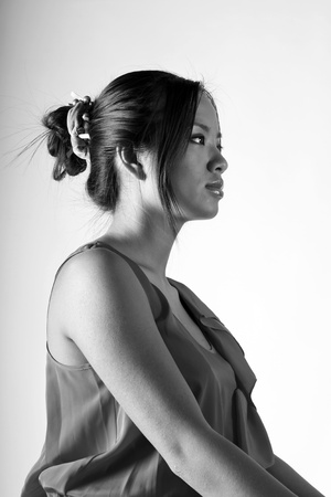Calm black and white portrait of a young beautiful woman Stock Photo - 9282484