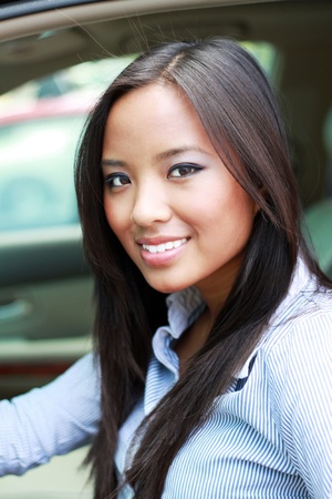 beautiful brunette asian businesswoman in a car photo