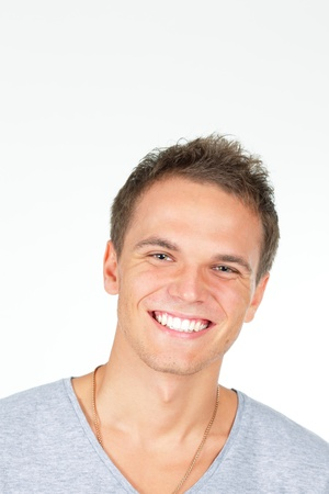Handsome young man laughing. Isolated on white background. Studio shot. Stock Photo - 9282441