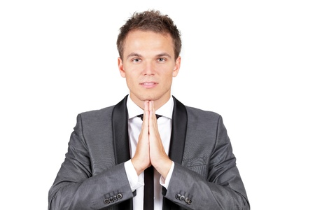 A trendy caucasian businessman making a prayer photo