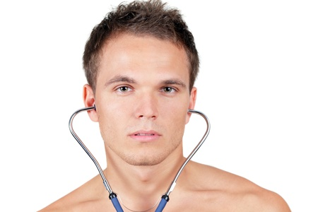 stethoscope boy: Portrait of a fit young man wuth stethoscope in his ears Stock Photo