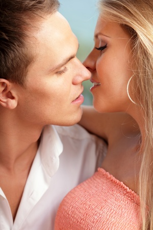 close-up portrait of a young loving couple ready to kiss photo