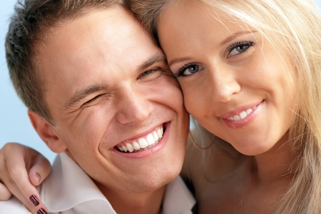 Close-up portrait of a cute young loving couple embracing  photo